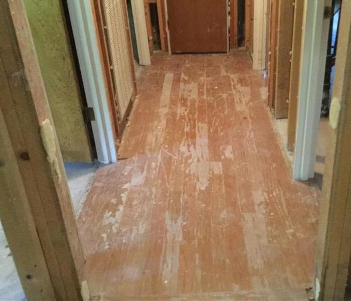Hallway after laminate flooring removal